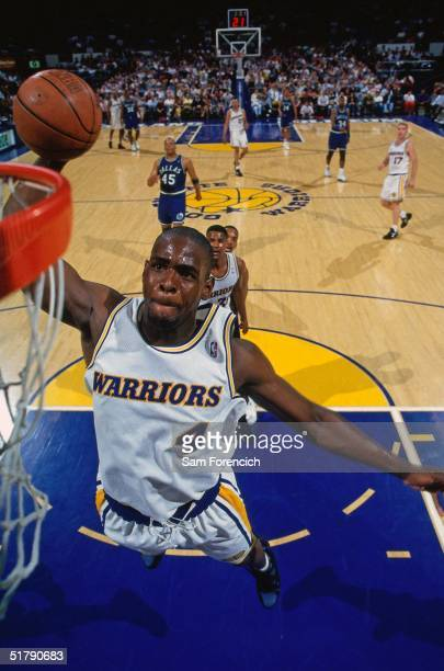 Chris Webber of the Golden State Warriors goes for a dunk against the Dallas Mavericks during the NBA game in Oakland, California. NOTE TO USER: User...