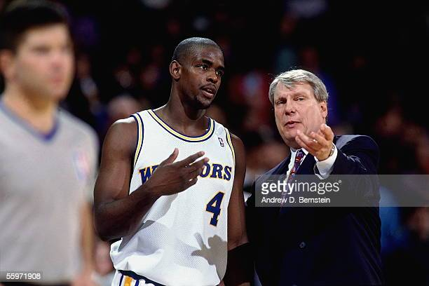 Chris Webber of the Golden State Warriors talks with head coach Don Nelson during a timeout during an NBA game against the Atlanta Hawks on February...