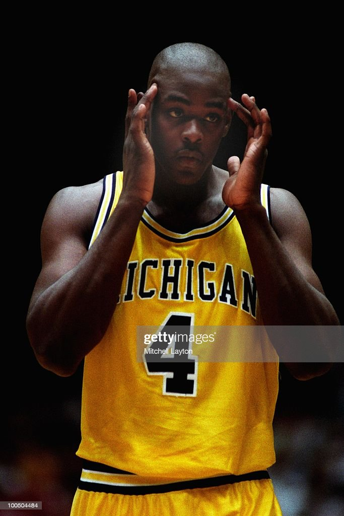 Chris Webber #4 of the Michigan Wolverines looks on during a NCAA second round basketball game at the McKale Center on March 21, 1993 in Tuscon, Arizona..