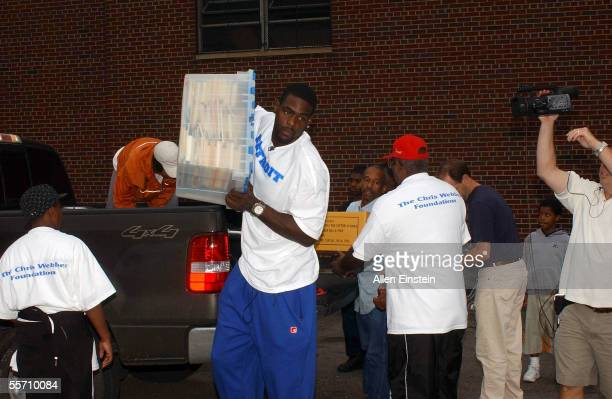 Chris Webber of the Philadelphia 76ers helps unload vechicles during his book and school supply donation drive for the youngest victims of Hurricane...