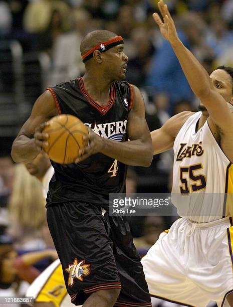 Chris Webber of the Philadelphia 76ers looks for an open teammate during the NBA game between the Los Angeles Lakers and the Philadelphia 76ers at...