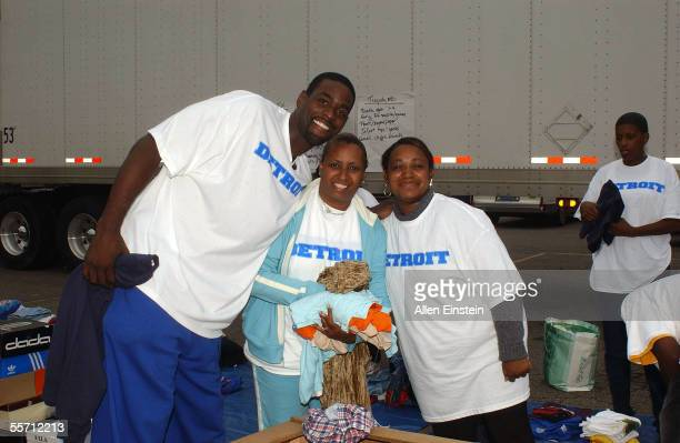 Chris Webber of the Philadelphia 76ers poses with volunteers sorting clothes during his book and school supply donation drive for the youngest...