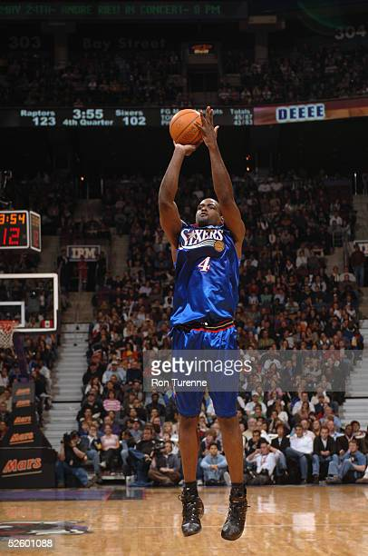 Chris Webber of the Philadelphia 76ers shoots against the Toronto Raptors during the game on March 13 2005 at the Air Canada Centre in Toronto Canada...
