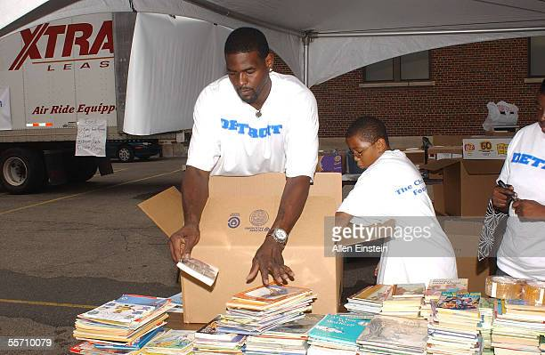 Chris Webber of the Philadelphia 76ers sorts students books during his book and school supply donation drive for the youngest victims of Hurricane...