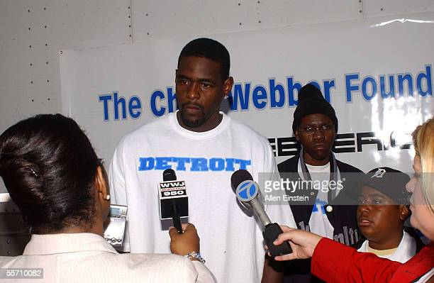 Chris Webber of the Philadelphia 76ers talks to the media during his book and school supply donation drive for the youngest victims of Hurricane...