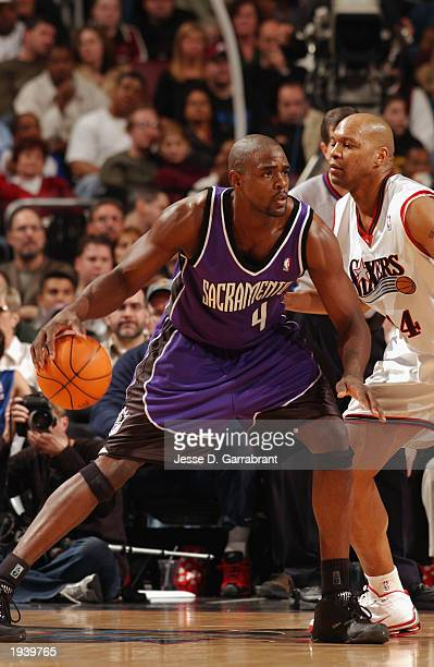 Chris Webber of the Sacramento Kings drives against Derrick Coleman of the Philadelphia 76ers during the NBA game at First Union Center on April 6...