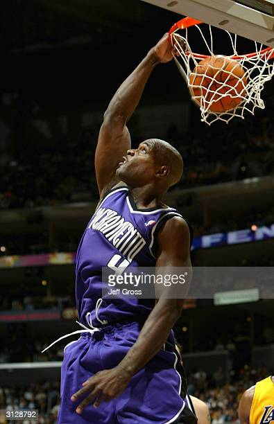 Chris Webber of the Sacramento Kings dunks against the Los Angeles Lakers March 24 2004 at Staples Center in Los Angeles California NOTE TO USER User...