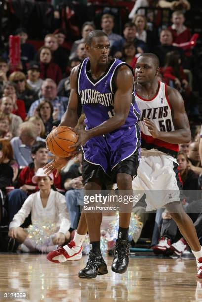 Chris Webber of the Sacramento Kings is covered by Zach Randolph of the Portland Trail Blazers during the game on March 12 2004 at the Rose Garden in...