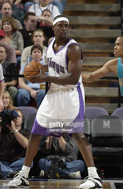 Chris Webber of the Sacramento Kings looks to move the ball against a New Orleans Hornets defender during the game at Arco Arena on April 6 2004 in...