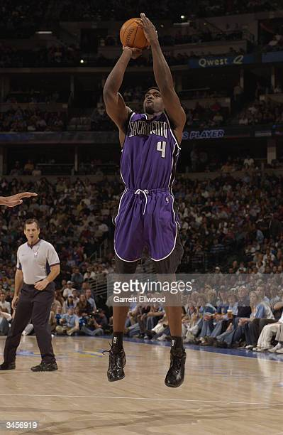 Chris Webber of the Sacramento Kings shoots against the Denver Nuggets during the game at Pepsi Center on April 12 2004 in Denver Colorado The...
