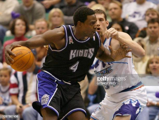 Chris Webber of the Sacramento Kings spins on Scott padgett of the Utah Jazz during the second quarter of game 3 at the first round of the Western...