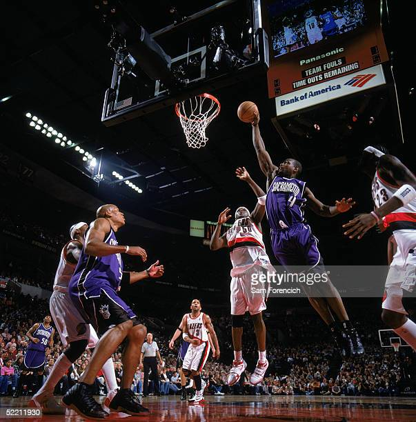 Chris Webber of the Sacramento Kings takes the ball to the basket past Zach Randolph of the Portland Trail Blazers during a game at The Rose Garden...