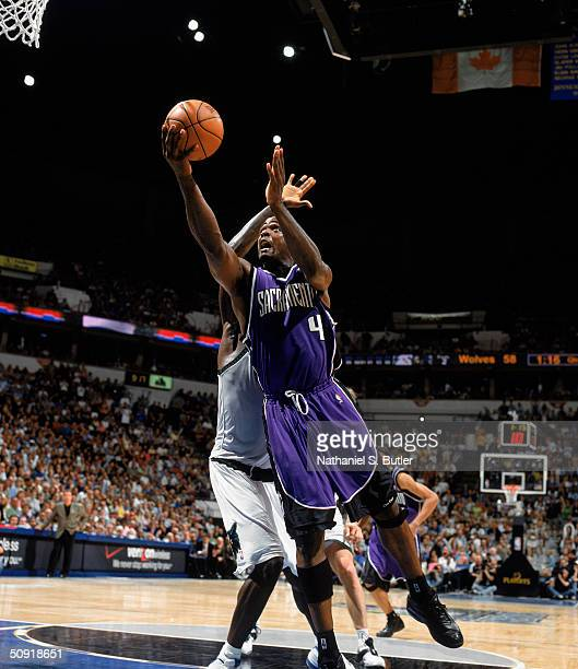 Chris Webber of the Sacramento Kings takes the ball up against the Minnesota Timberwolves in Game Seven of the Western Conference Semifinals during...