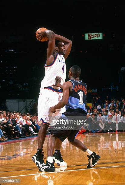 Chris Webber of the Washington Bullets looks to pass the ball over the top of Terrell Brandon of the Cleveland Cavaliers during an NBA basketball...