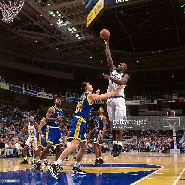 Chris Webber of the Washington Bullets shoots the ball against the Golden State Warriors during a game played on December 15 1996 at the San Jose...