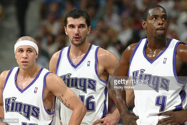 Chris Webber Predrag Stojakovic and Mike Bibby of the Sacramento Kings are shown during a break in the action against the Minnesota Timberwolves in...