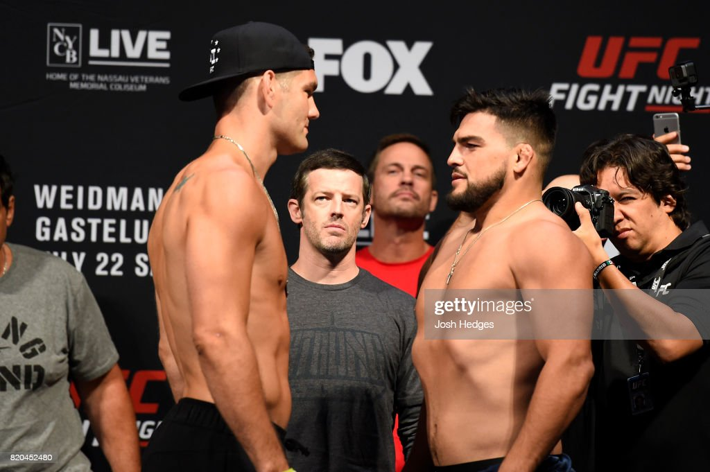 Chris Weidman and Kelvin Gastelum face off during the UFC Fight Night weigh-in inside the Nassau Veterans Memorial Coliseum on July 21, 2017 in Uniondale, New York.