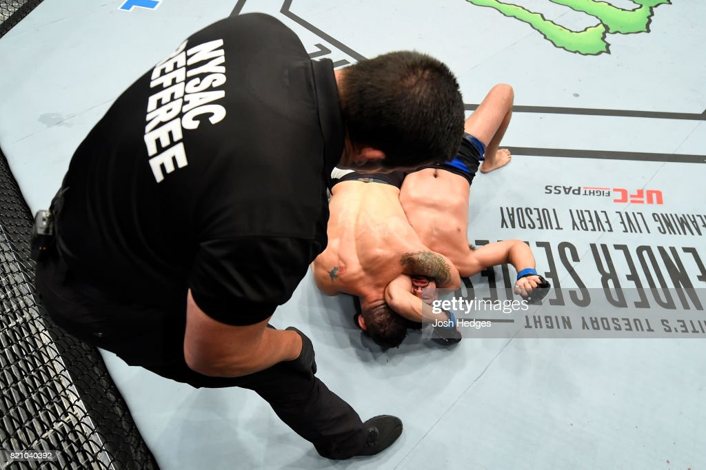 Chris Weidman attempts to submit Kelvin Gastelum in their middleweight bout during the UFC Fight Night event inside the Nassau Veterans Memorial Coliseum on July 22, 2017 in Uniondale, New York.