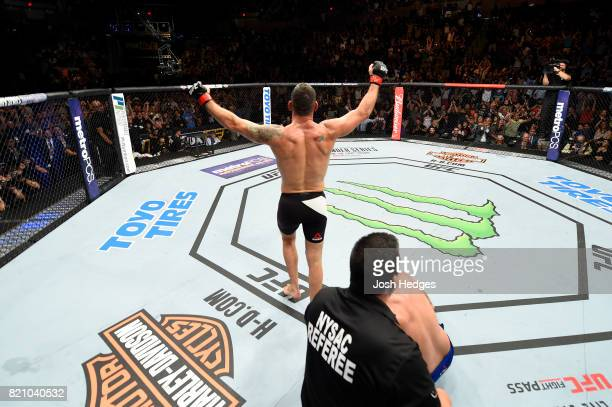 Chris Weidman celebrates after submitting Kelvin Gastelum in their middleweight bout during the UFC Fight Night event inside the Nassau Veterans...