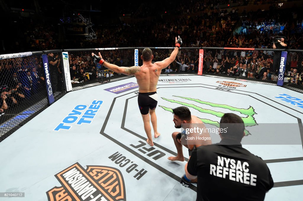 Chris Weidman celebrates after submitting Kelvin Gastelum in their middleweight bout during the UFC Fight Night event inside the Nassau Veterans Memorial Coliseum on July 22, 2017 in Uniondale, New York.
