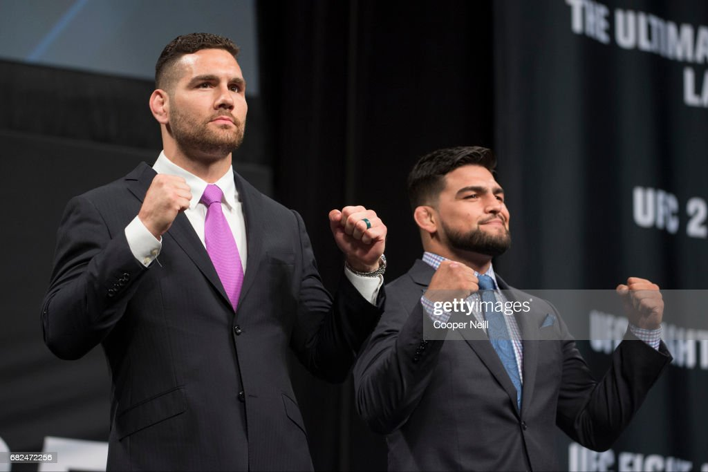 Chris Weidman faces off with Kelvin Gastelum during the UFC Summer Kickoff Press Conference at the American Airlines Center on May 12, 2017 in Dallas, Texas.