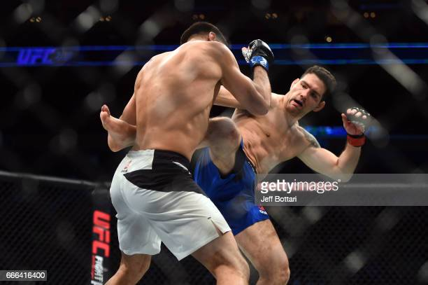 Chris Weidman kicks Gegard Mousasi of the Netherlands in their middleweight bout during the UFC 210 event at the KeyBank Center on April 8 2017 in...