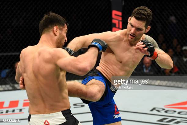 Chris Weidman lands a kick on Gegard Mousasi of the Netherlands in their middleweight bout during the UFC 210 event at KeyBank Center on April 8 2017...