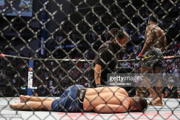 Chris Weidman of the United States breaks his leg on a kick attempt on Uriah Hall of Jamaica during UFC 261 at VyStar Veterans Memorial Arena on...