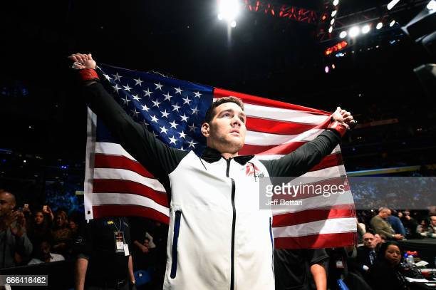 Chris Weidman prepares to enter the Octagon prior to facing Gegard Mousasi of the Netherlands in their middleweight bout during the UFC 210 event at...
