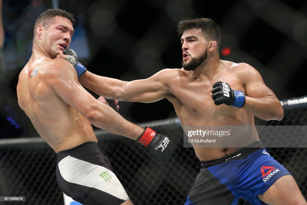 Chris Weidman (L) takes a right hand from Kelvin Gastelum (R) during their UFC Fight Night middleweight bout at the Nassau Veterans Memorial Coliseum on July 22, 2017 in Uniondale, New York.