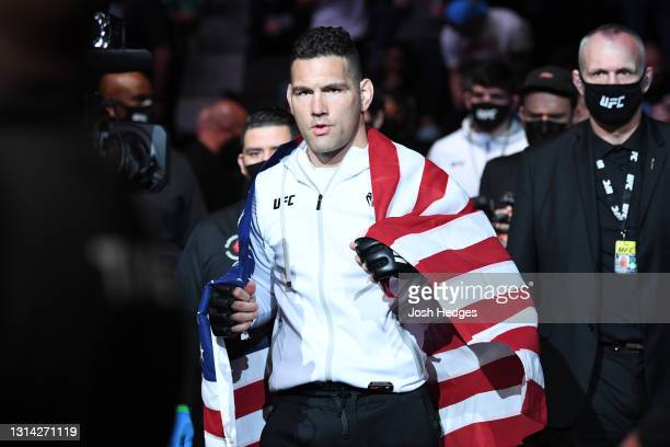 Chris Weidman walks out towards the Octagon prior to facing Uriah Hall of Jamaica in their middleweight bout during the UFC 261 event at VyStar...