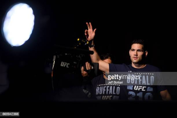 Chris Weidman walks towards the stage during the UFC 210 weighin at KeyBank Center on April 7 2017 in Buffalo New York