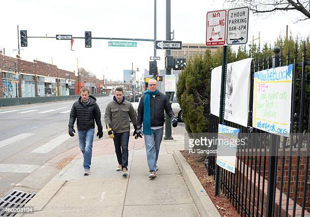 Chris Weiss left Charles Annerino center and Dan Hanley all of Urban Peak walk during the 24 hour period of Colorado Gives Day to raise money and...