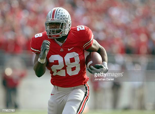 Chris Wells of the Ohio State Buckeyes carries the ball during the game against the Wisconsin Badgers on November 3, 2007 at Ohio Stadium in...