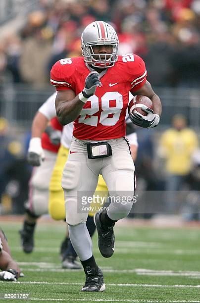 Chris Wells of the Ohio State Buckeyes carries the ball during the Big Ten Conference game against the Michigan Wolverines at Ohio Stadium on...