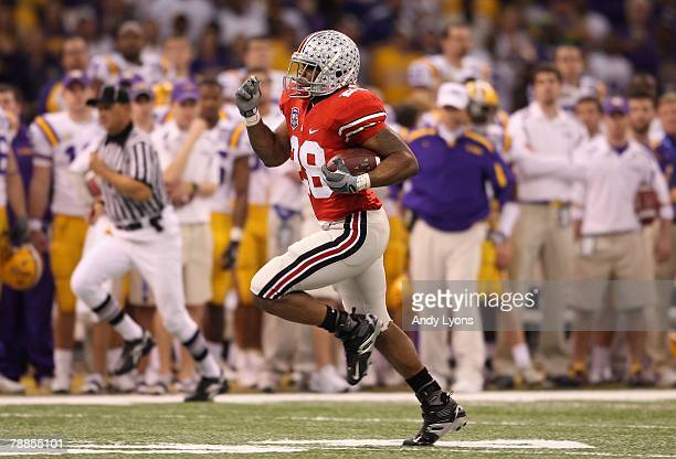 Chris Wells of the Ohio State Buckeyes runs for a 65yard touchdown in the first quarter against the Louisiana State University Tigers during the...