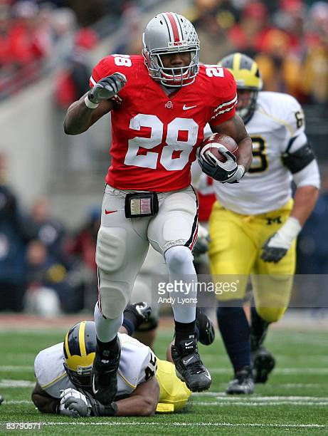 Chris Wells of the Ohio State Buckeyes runs for a touchdown during the Big Ten Conference game against the Michigan Wolverines at Ohio Stadium on...