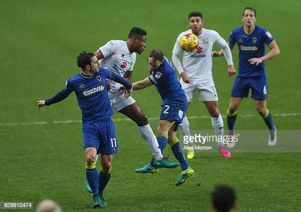 Chris Whelpdale of AFC Wimbledon and Chuks Aneke of MK Dons battle to win a header during the Sky Bet League One match between Milton Keynes Dons and...