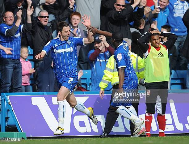 Chris Whelpdale of Gillingham celebrates scoring their second goal during the npower League 2 match between Gillingham and Swindon Town at...