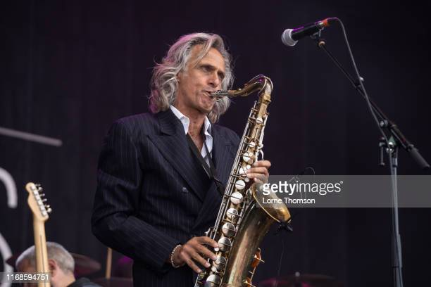 Chris White of The Dire Straits Experience performs at Rewind South on August 17 2019 in HenleyonThames England