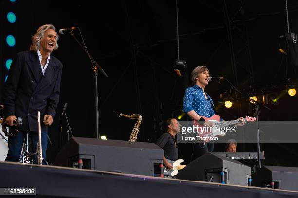 Chris White Terence Reis and Tim Walters of the Dire Straits Experience performs at Rewind South on August 17 2019 in HenleyonThames England