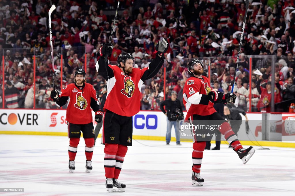 Chris Wideman #6 and Bobby Ryan #9 of the Ottawa Senators celebrate after defeating the Pittsburgh Penguins with a score of 2 to 1 in Game Six of the Eastern Conference Final during the 2017 NHL Stanley Cup Playoffs at Canadian Tire Centre on May 23, 2017 in Ottawa, Canada.