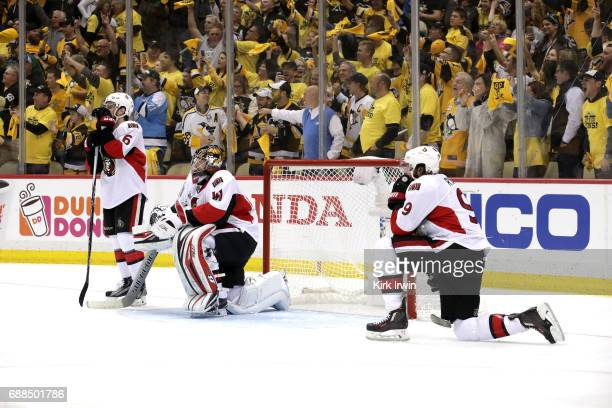 Chris Wideman Craig Anderson and Bobby Ryan of the Ottawa Senators react after the game winning goal by Chris Kunitz of the Pittsburgh Penguins in...