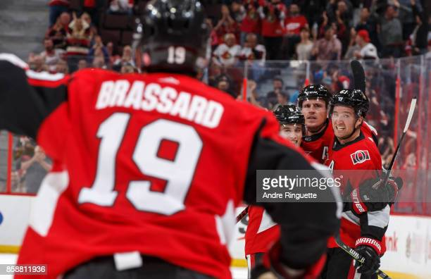 Chris Wideman Dion Phaneuf and Mark Stone of the Ottawa Senators look on as Derick Brassard celebrates his third period goal against the Detroit Red...