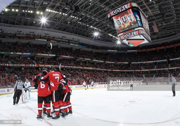 Chris Wideman of the Ottawa Senators celebrates his first period goal against the Los Angeles Kings with teammates including Brady Tkachuk at...