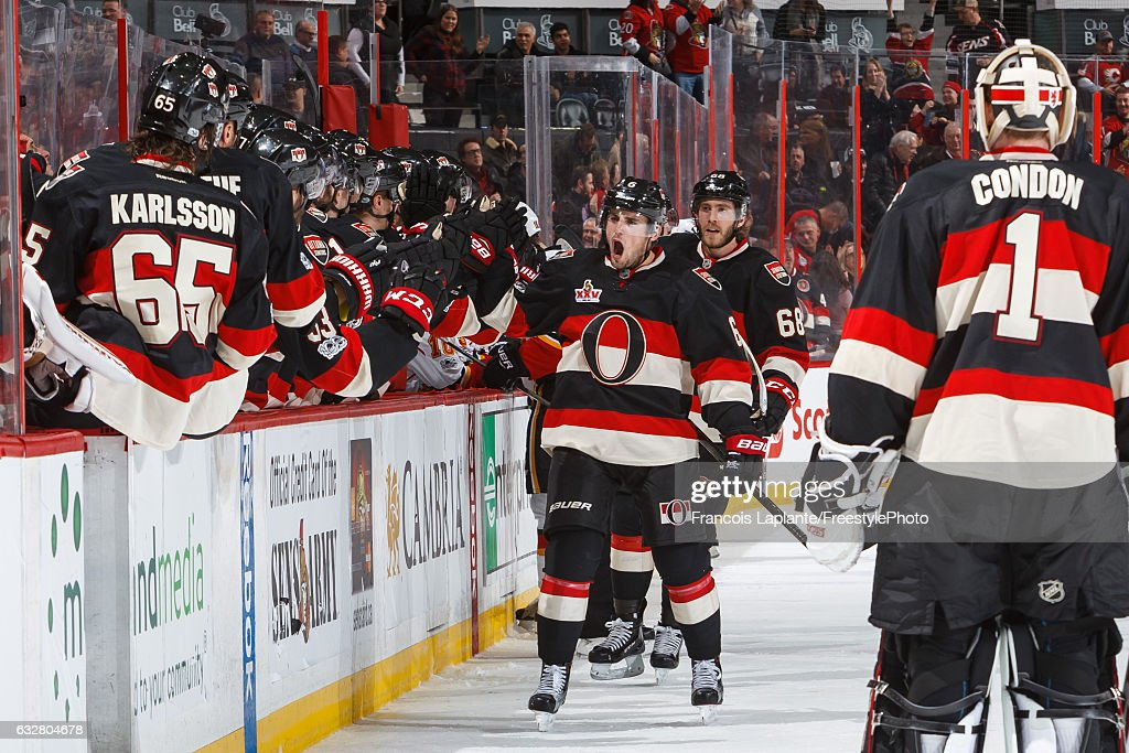 Chris Wideman #6 of the Ottawa Senators celebrates his game-tying goal at the bench with teammates during an NHL game against the Calgary Flames at Canadian Tire Centre on January 26, 2017 in Ottawa, Ontario, Canada.