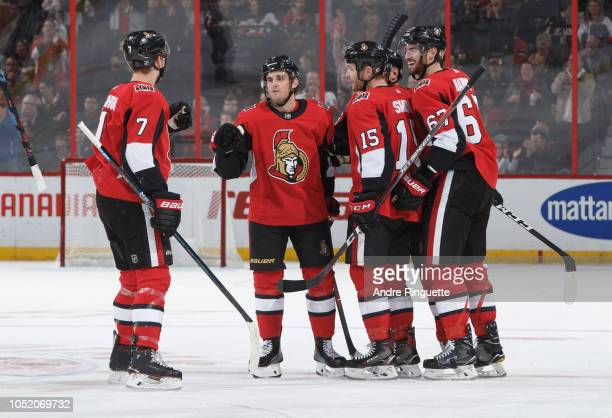 Chris Wideman of the Ottawa Senators celebrates his third period goal against the Los Angeles Kings with teammates Brady Tkachuk Zack Smith and Ben...