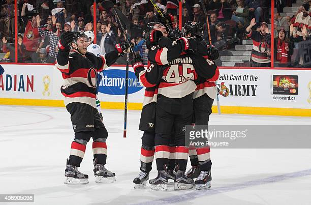 Chris Wideman of the Ottawa Senators celebrates his third period goal against the Vancouver Canucks with teammates Curtis Lazar and Mark Stone at...