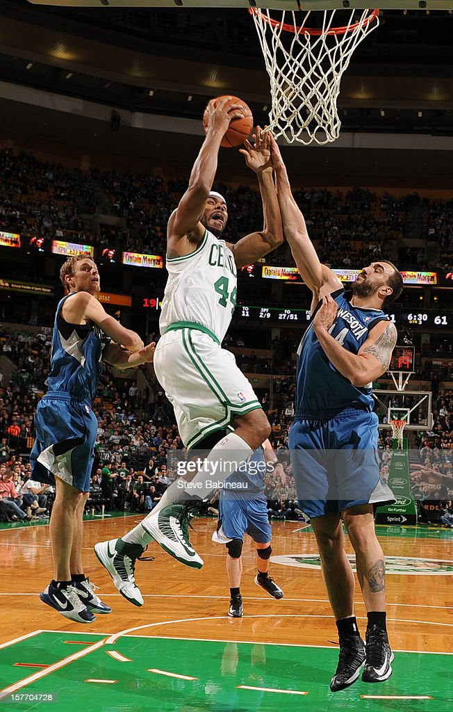 Chris Wilcox #44 of the Boston Celtics goes to the basket against Nikola Pekovic #14 of the Minnesota Timberwolves on December 5, 2012 at the TD Garden in Boston, Massachusetts.