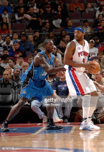 Chris Wilcox of the Detroit Pistons looks to maneuver against Brandon Bass of the Orlando Magic during the game on November 3 2009 at The Palace of...